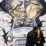 1-a-couple-poses-to-have-a-photo-taken-by-a-passer-by-as-they-visit-a-reproduction-of-the-berlin-wall-outside-the-german-embassy-in-madrid_217